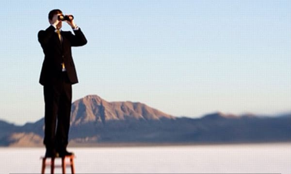 Sales recruiter looking with binoculars to find sales talent